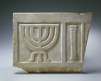 Sarcophagus fragment, circa third–fourth century C.E. Carved marble, showing a seven-branched menorah, the Jewish Museum, New York.