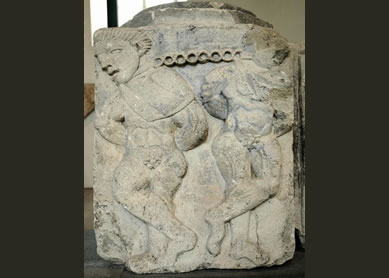 Roman pedestal or pillar base, showing two chained captives, most likely about to be sold as slaves, circa 50-100 C.E.
