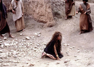 Mary Magdalene is stoned for breaking the law in Martin Scorsese's The Last Temptation of Christ.