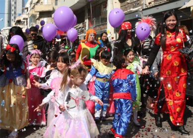 Children of migrant workers wear costumes as they celebrate Purim in south Tel Aviv.