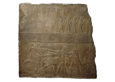 Tiglath-pileser III in his war chariot, late eighth century B.C.E.  Neo-Assyrian Alabaster panel from Nimrud, British Museum, London.