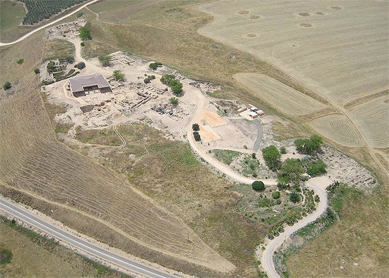 Aerial view of Tel Hazor. The Bronze Age monumental buildings are covered by a roofed structure (upper-left part of the photo).