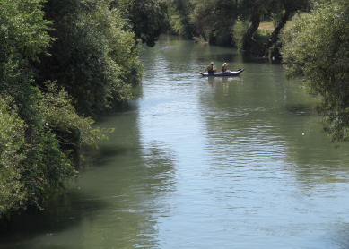 Kayakers on the Jordan River near Kibbutz Amir, Israel, 2012.