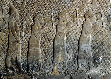 Prisoners, probably from Phoenicia or Palestine, playing lyres. Detail of a stone relief from Sennacherib's South-West palace at Nineveh, circa 704–681 B.C.E. The British Museum, London.