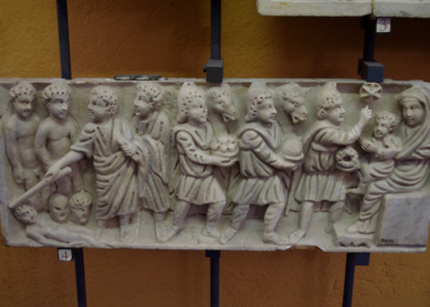 "An early Christian sarcophagus, probably from the fourth century C.E. At left, a young bearded Jesus performs a healing miracle with his ""magic wand."" At right, three Magi bring gifts to Mary and the child Jesus. The first Magus point to the Star of Bethlehem overhead. Vatican Museums, Vatican City."